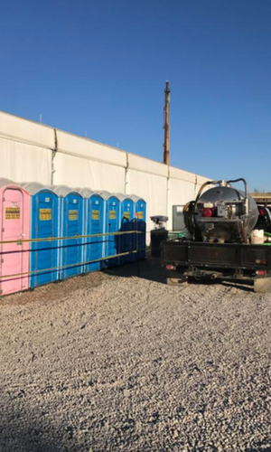 blue and pink portable toilets